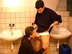 Two naughty twinks sucking rods in public lavatory