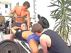 Young muscle gays suck cocks in gym