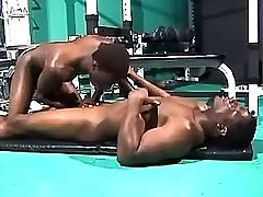 Black gay sucks chocolate cock in gym