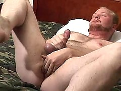 Mature gay masturbates and caresses hole