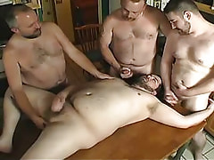 Mature gays relax on kitchen