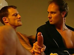 Cute gay plays with hard cock on sofa