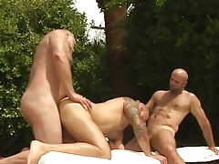 Lusty mature bears suck and fuck in orgy outdoor