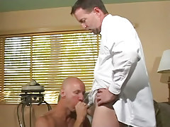 Bald gay greedily sucks appetizing cock