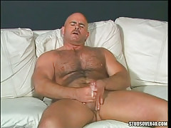 Horny bear gay cums after handjob