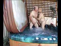 Fat mature gays kissing in pool