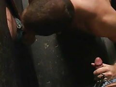 Gay stud sucks two cocks by turns